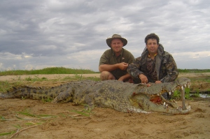 Rick and Gary with an impressive Croc on the Mighty Zambezi River!