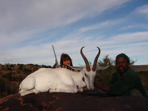 Shellie & Boy admiring Shellie's first African Trophy. White Springbuck.